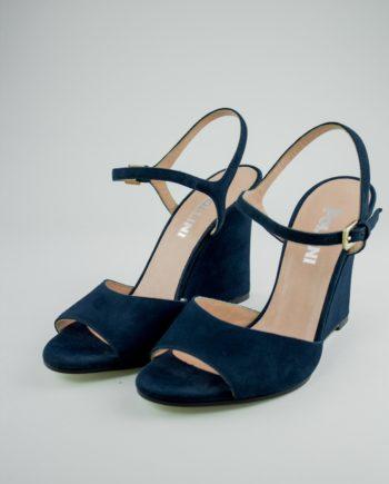 25. POLLINI Blue wedge heels